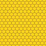 Honeycomb yellow seamless vector pattern. Reticulate honey repeating background Stock Images