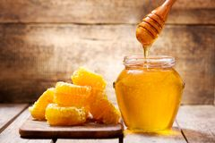 Free Honeycombs And Jar Of Honey Stock Photography - 109664332
