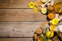 Honeycombs ,honey, ginger, pollen, lemon. On a wooden table Stock Images
