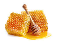 Honeycombs with spoon Stock Photos