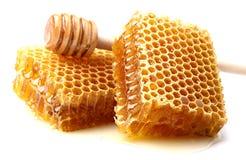 Honeycombs z łyżką Zdjęcia Royalty Free