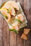 Honeydew melon juice closeup on wooden background, vertical top Stock Photography