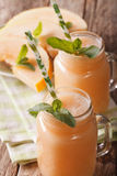 Honeydew melon smoothie ith mint macro in a glass jar. Vertical Stock Photography