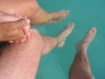 Honeymoon. Young Couple Enjoying the Pool Royalty Free Stock Images