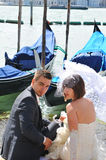 Honeymoon. Venice, Italy - 6 May, 2012: Newly married couple on honeymoon enjoy the view of the Venetian Grand Canal Royalty Free Stock Photo
