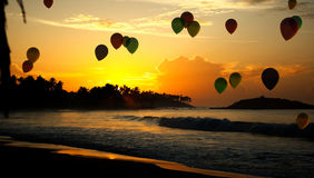 Honeymoon. The evening sunset, and balloons, the sea Stock Images