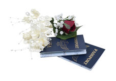 Honeymoon Abroad. Shown by a pair of passports with a boutonniere and corsage - path included Royalty Free Stock Images