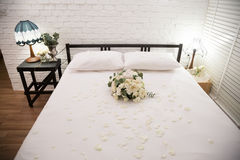 Honeymoon bed. Decorated with white rose Stock Image