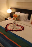 Honeymoon Bed. Two swans and heart made from towels on honeymoon bed in a Hotel room Royalty Free Stock Image