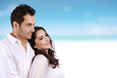Honeymoon. Closeup portrait of beautiful women with handsome men spending time on the beach, honeymoon vacation, summer holidays concept Stock Images