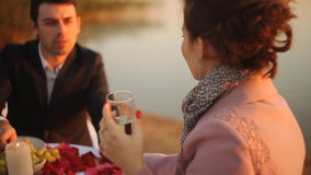 Honeymoon concept, Couple enjoying glass of champagne at sunset stock footage