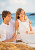 Honeymoon concept, Man and Woman in love. Man and Woman in love, Couple enjoying glass of champagne on tropical beach at sunset, Honeymoon concept Royalty Free Stock Images