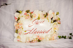 Honeymoon concept. White plate with tropical flowers Stock Image