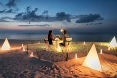 Honeymoon couple is having a private, romantic dinner. At a tropical beach stock photo