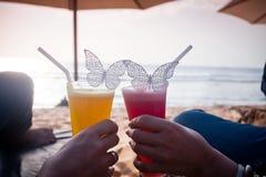 Honeymoon couple lying at sunbed near the blue ocean Royalty Free Stock Photos