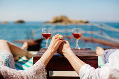Honeymoon couple relax on beach. Holding hands together with vine background Royalty Free Stock Image