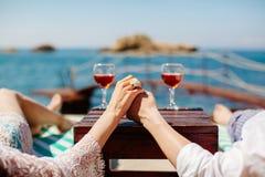 Honeymoon couple relax on beach Royalty Free Stock Image