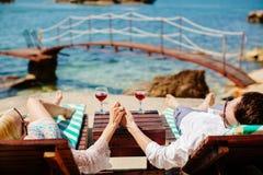 Honeymoon couple relax on beach Royalty Free Stock Photo