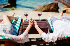 Honeymoon couple relax on beach wth sea view Stock Photography