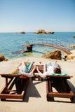 Honeymoon couple relax on beach wth sea view Royalty Free Stock Image