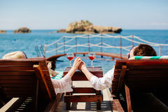 Honeymoon couple relax on beach wth sea view Royalty Free Stock Images