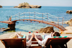 Honeymoon couple relax on beach wth sea view Royalty Free Stock Photos
