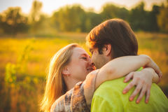 Honeymoon couple romantic in love at field and trees sunset. Newlywed happy young couple embracing enjoying nature Royalty Free Stock Images