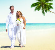 Honeymoon Couple Romantic Walking Summer Beach Concept.  Royalty Free Stock Image