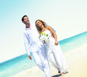 Honeymoon Couple Romantic Walking Summer Beach Concept.  Stock Photography