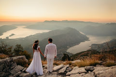 Honeymoon couple travel mountains and sea view. Sunset in picturesque mountains. Kotor Bay, Montenegro Royalty Free Stock Photography