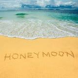 Honeymoon drawn in a sandy tropical beach Stock Photo