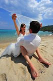 Honeymoon euphoria - bride and groom Stock Photos