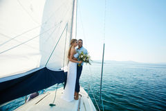 Honeymoon. Happy married couple traveling by yacht during honeymoon stock photos