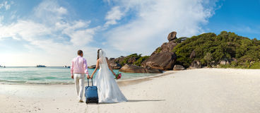 Honeymoon. Happy newly married couple  in honeymoon, on sun sandy beach in Thailand Stock Image