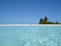 Honeymoon Island. View of Honeymoon Island from the water with two people sunbathing on the beach Stock Photo