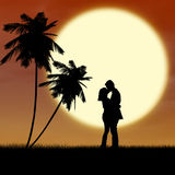Honeymoon romantic couple silhouette. Young couple is kissing near palm trees by sunset on the beach Royalty Free Stock Image
