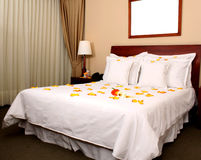 Honeymoon suite in a hotel. With roses in the bed Royalty Free Stock Photography