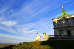 Honeymoon Trip, Bride in Wedding Dress over Blue Sky, Romantic Travel Concept, Looking Ahead. selective focus free space for text stock photo