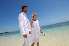 Honeymoon on tropical beach Stock Photos