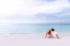 Honeymoon vacation. Portrait of beautiful young couple hugging outdoors, spending romantic honeymoon vacation on luxury beach resort, summer time concept Stock Photography