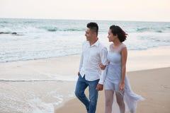 Honeymoon. Young Asian couple spending honeymoon on the beach stock photo