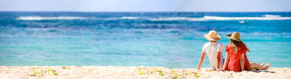 Honeymooners. Panoramic photo of romantic couple in tropical paradise Stock Photo