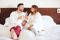 Honeymooners celebrating in a hotel Royalty Free Stock Photography