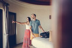 Honeymooners checking in to a hotel room royalty free stock images