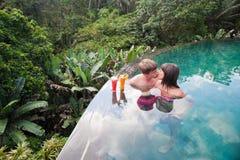 Honeymooners couple at pool nea hotel Stock Photography