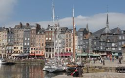 Honfleur. Boat moored ouside customs house in Honfleur harbour stock image