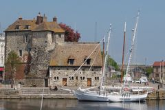 Honfleur 2. Boat moored ouside customs house in Honfleur harbour royalty free stock image