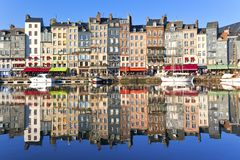 Honfleur, France. Honfleur harbour in Normandy, France. Color houses and their reflection in water Royalty Free Stock Image