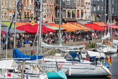 Harbor historic city Honfleur with moored sailing ships and restaurants Stock Photos