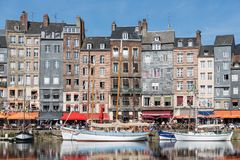 Harbor of historic Frenc city Honfleur with ships and restaurants Royalty Free Stock Photography